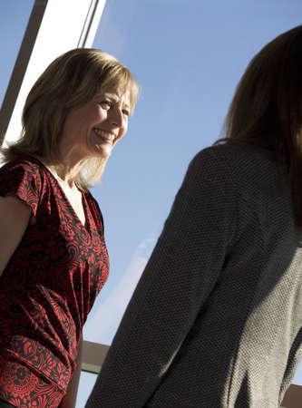 50 something: Two women talking Stock Photo