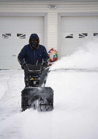 carson ganci: Man operating a snow blower