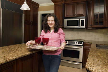 Young adult in the kitchen Stock Photo - 7209789