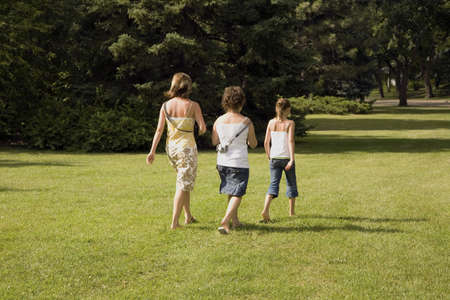 Family walking in the park Stock Photo - 7210504