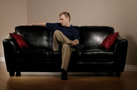 Man sitting on couch alone Stock Photo - 7207710