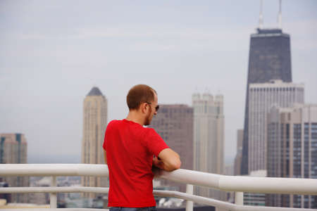 A man viewing downtown Chicago photo