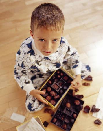 ron: Boy into box of chocolates Stock Photo