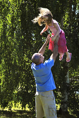 silliness: Father being playful with daughter