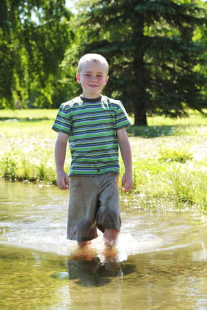 Boy standing in the water Stock Photo - 7209470