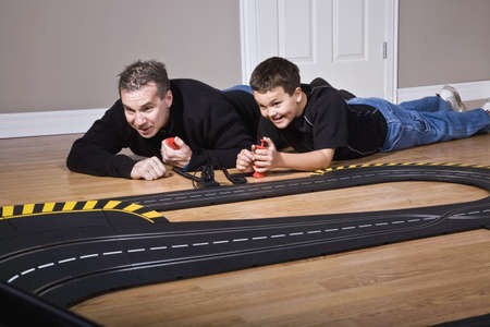 antagonistic: Father and son playing with racetrack