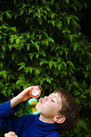Boy blowing bubbles Stock Photo - 7205549