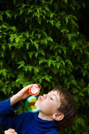 Boy blowing bubbles Stock Photo - 7205549