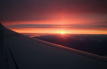 flight mode: The wing of a plane against a sunset