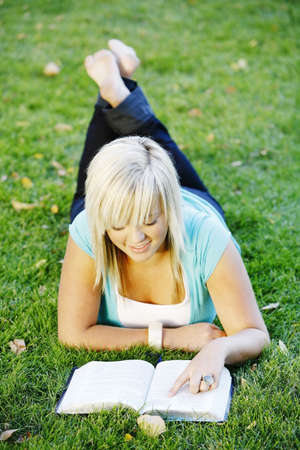 bookish: A teenage girl reading her Bible Stock Photo