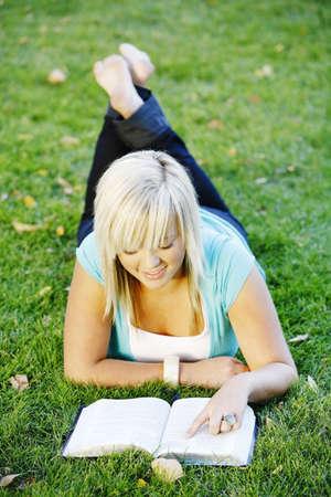 bookish: A teenage girl reading her Bible Stock Photo