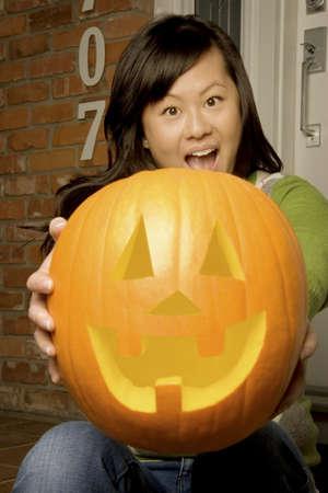 jackolantern: Girl holding jack-o-lantern