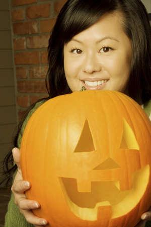 jackolantern: Girl holding a jack-o-lantern