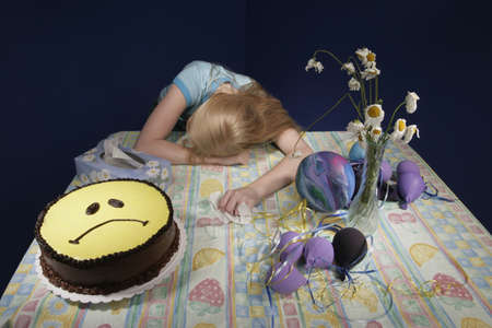 Upset girl surrounded by party supplies