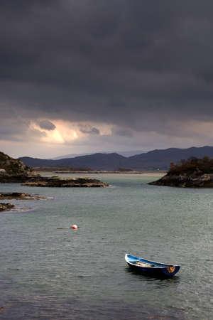 Boat in water,Loch Sunart,Scotland photo