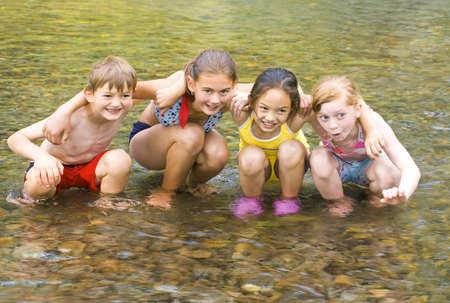 children pond: Children playing in water