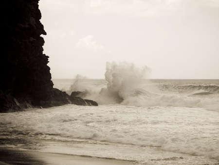 sepias: Waves against a cliff,Napali Coast State Park,Kauai,Hawaii