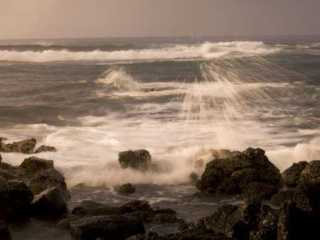 Waves crashing against the rocks,Poipu,Kauai,Hawaii photo