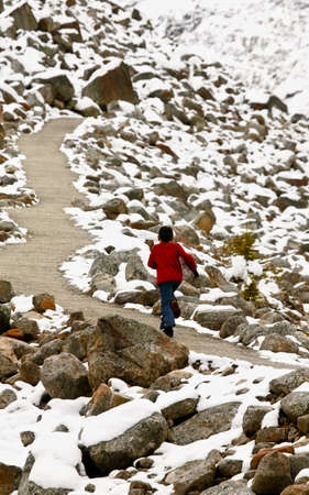 Walking along pathway among snow covered rocks Stock Photo - 7209473