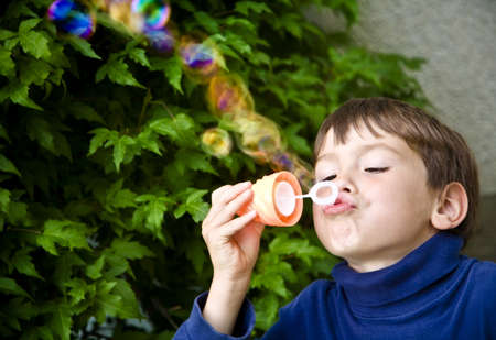 tanasiuk: Boy playing with bubbles