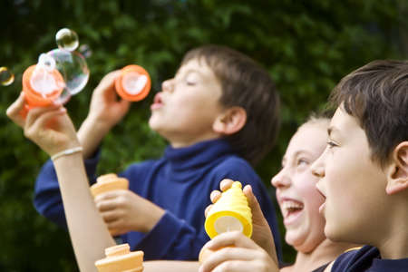 Children blowing bubbles Stock Photo - 7205592