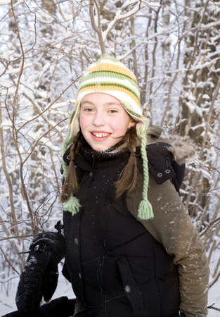 Portrait of girl in winter clothing photo