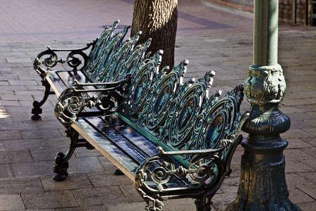 sidewalks: Cast iron benches Stock Photo