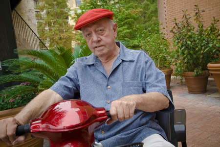 recreational vehicle: Man on a motorized scooter Stock Photo