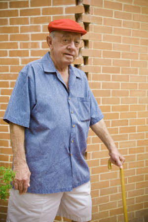 seventy something: A man walking with a cane
