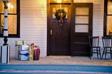 tanasiuk: Christmas gifts outside the front door Stock Photo