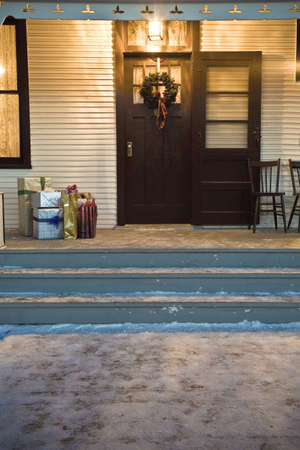 porches: Christmas gifts on porch Stock Photo