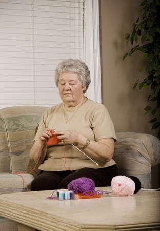 Woman knitting photo