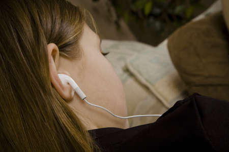 Girl with ear buds photo