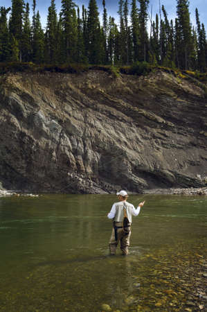 Man fly fishing in mountain river