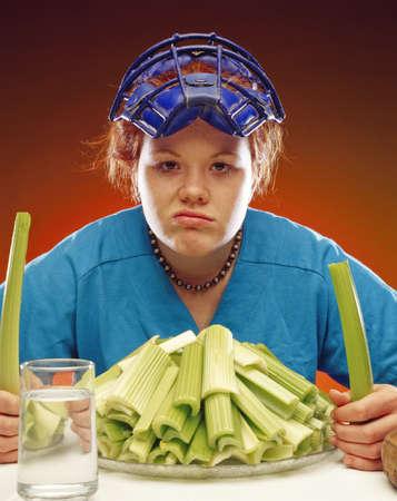 Woman in sports gear eating celery