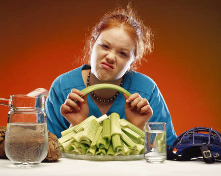 twentysomething: Women with plate of celery and sports equipment