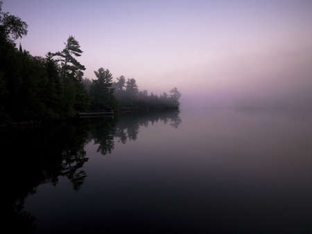 Lake of the Woods,Ontario,Canada,Reflections on a lake Stock Photo - 7208157