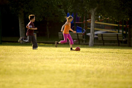 Two kids playing soccer photo