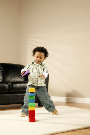 balancing: A boy playing with blocks