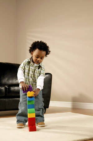 A boy playing with blocks