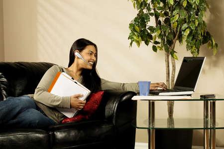 A woman using a laptop photo