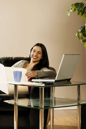 eyecontact: A woman working at home Stock Photo