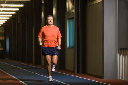 indoors: Man running Stock Photo