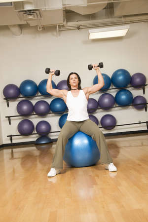 something athletic: Woman toning muscles Stock Photo