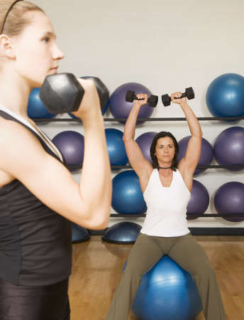Two women exercising photo