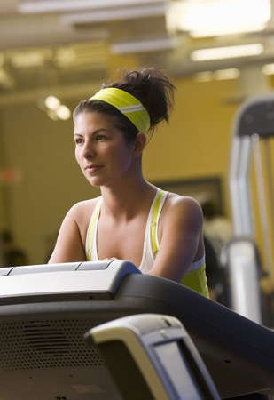something athletic: Woman running on treadmill