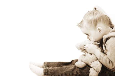 sepias: Girl holding her teddy bear