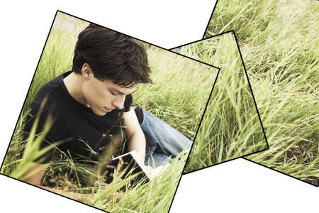 Teenage boy reading in the grass photo