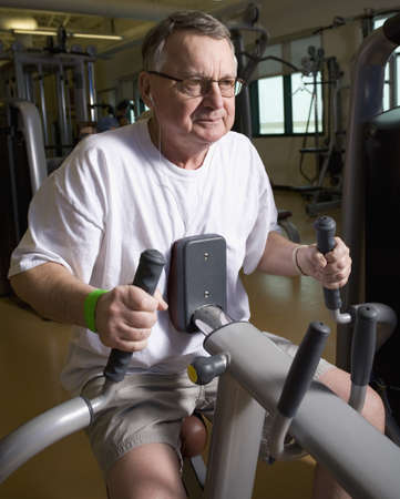 seventy something: Man on a workout machine Stock Photo