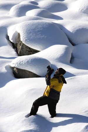 vacationing: Photographer in the snow, Jasper National Park, Alberta, Canada Stock Photo